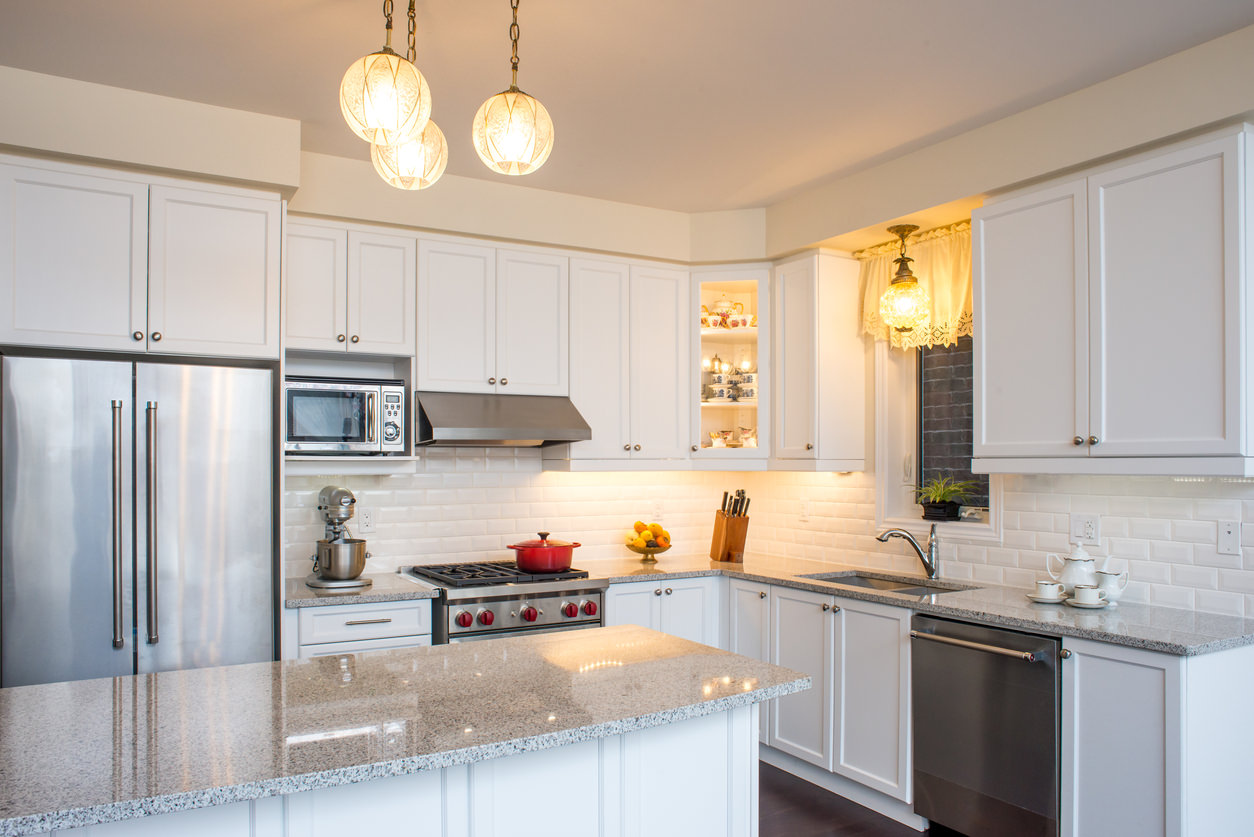 Luna pearl granite kitchen white cabinets and subway tile